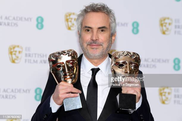 Winner of the Best Director and Best Film awards for Roma director Alfonso Cuaron poses in the press room during the EE British Academy Film Awards...