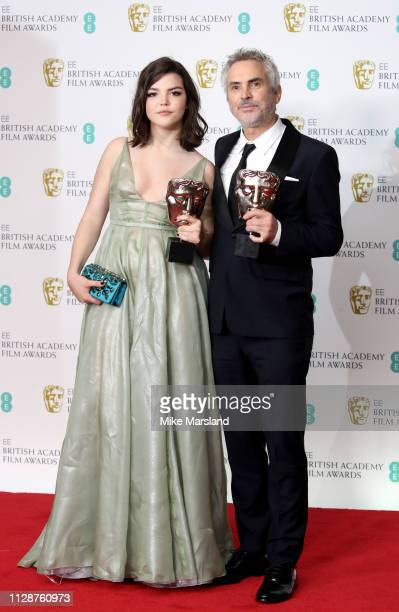 Winner of the Best Director and Best Film awards for Roma director Alfonso Cuaron and his daughter Tess Bu Cuaron pose in the press room during the...