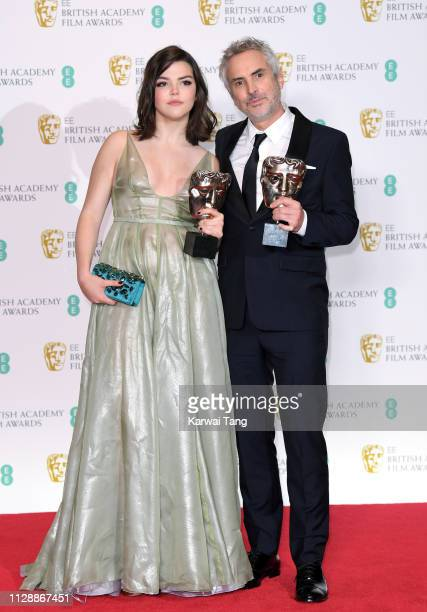 Winner of the Best Director and Best Film awards for Roma director Alfonso Cuaron with Tess Bu Cuaron pose in the press room at the EE British...