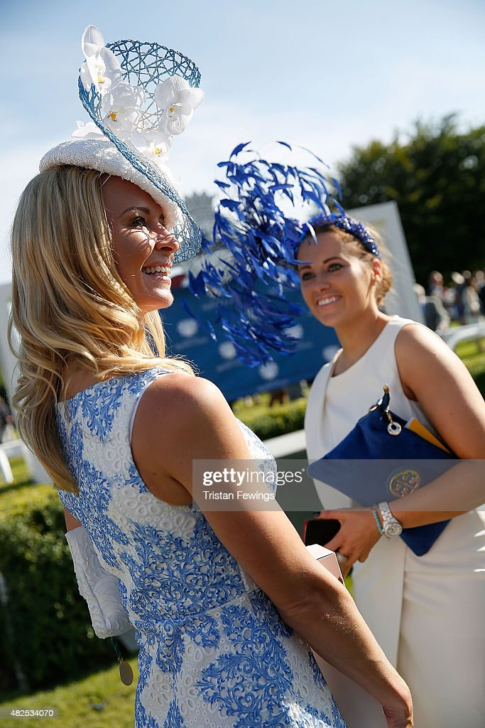 Winner of the Best Dressed competition, Rachel Hawkins (L) on day four of the Qatar Goodwood Festival at Goodwood Racecourse on July 31, 2015 in Chichester, England.