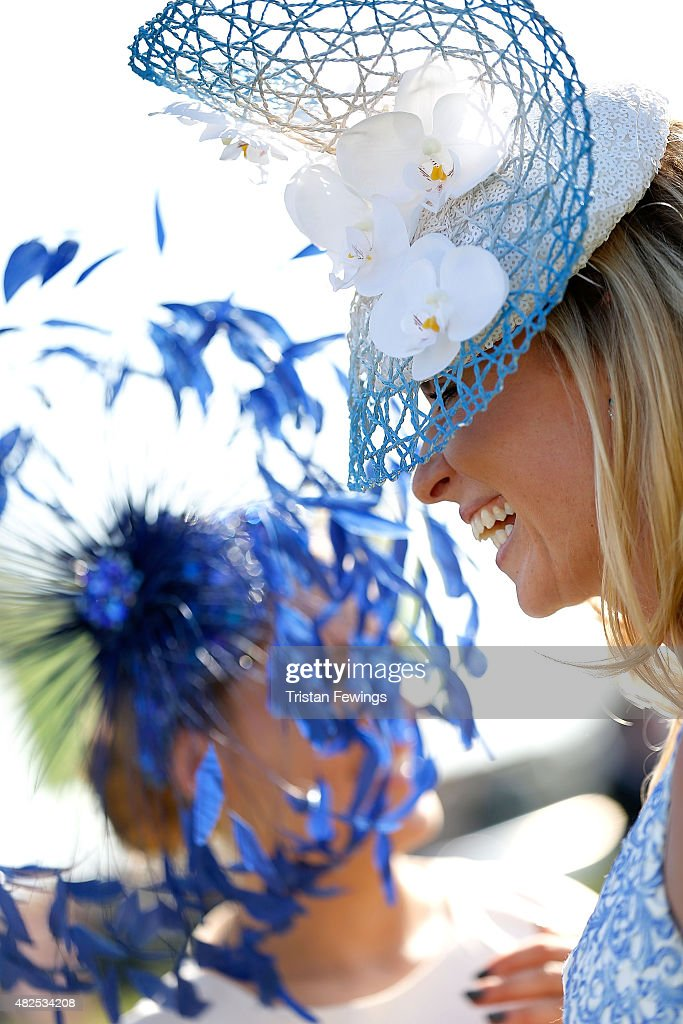 Winner of the Best Dressed competition, Rachel Hawkins (R) on day four of the Qatar Goodwood Festival at Goodwood Racecourse on July 31, 2015 in Chichester, England.