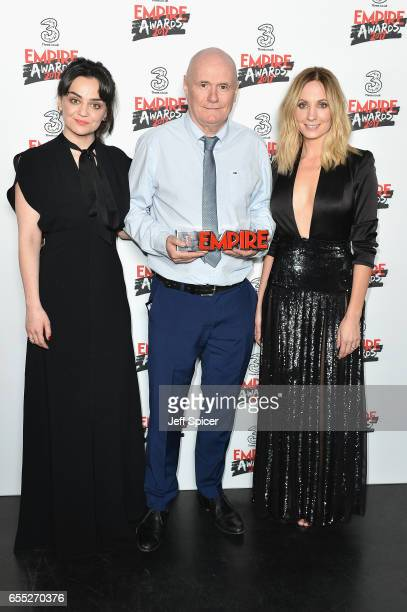 Winner of the Best Male Newcomer award actor Dave Johns poses with actresses Hayley Squires and Joanne Froggatt in the winners room at the THREE...