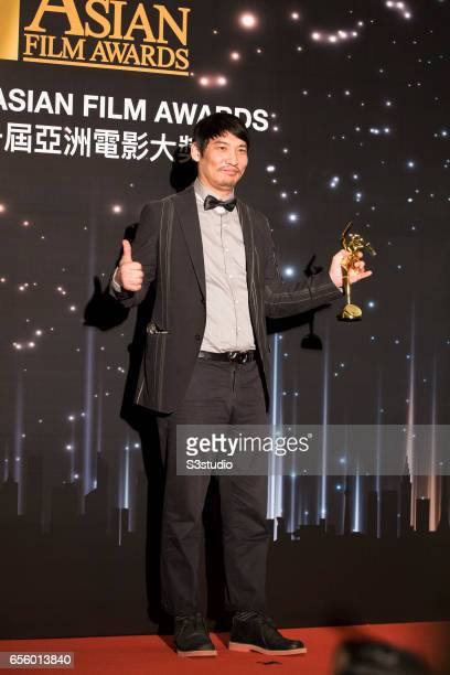 Winner of the Best Original Music award for 'The Age of Shadows', poses with the award during the 11th Asian Film Awards on March 21, 2017 at Hong...