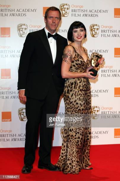 Winner of the Best Original Screenplay Diablo Cody poses with actor Hugh Laurie in the Press Room during The Orange British Academy Film Awards 2008...