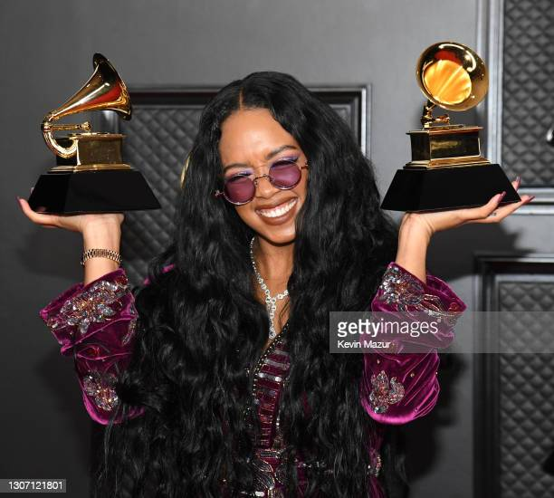 Winner of the Best R&B Song award for 'Better Than I Imagined' and the Song of the Year award for 'I Can't Breathe,' poses in the media room during...