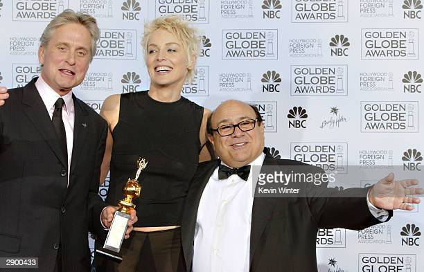 Winner of the Cecil B DeMille Award Actor Michael Douglas Actress Sharon Stone and Actor/Director Danny DeVito pose backstage at the 61st Annual...