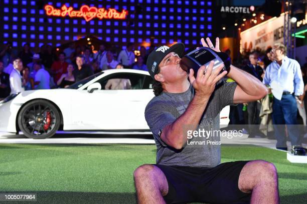 Winner of the challenge Pat Perez pose for photographers with a large key during the Porsche Urban Golf Challenge on the Reeperbahn on July 24 2018...