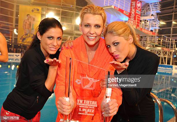 Winner of the competition actress Alexandra Rietz and playmates Margerita Waldmann and Julia Schober pose during the TV Total Turmspringen - TV Show...