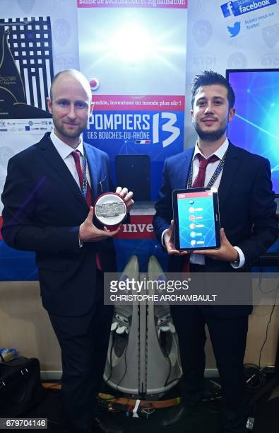 Winner of the 'Concours Lepine International Paris 2017' Alexandre Defromont from Eydi technology poses with a signalisation and location beacon at...