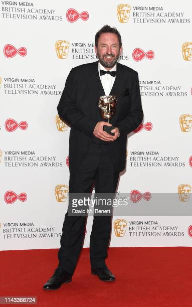 Winner of the Entertainment Performance award for 'Would I Lie To You' Lee Mack poses in the press room at the Virgin Media British Academy...