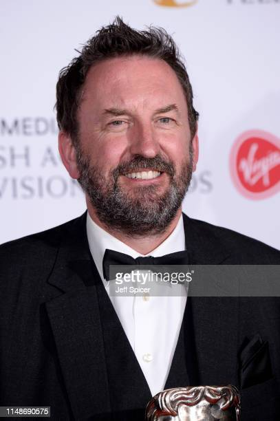 Winner of the Entertainment Performance award for 'Would I Lie To You?', Lee Mack poses in the Press Room at the Virgin TV BAFTA Television Award at...