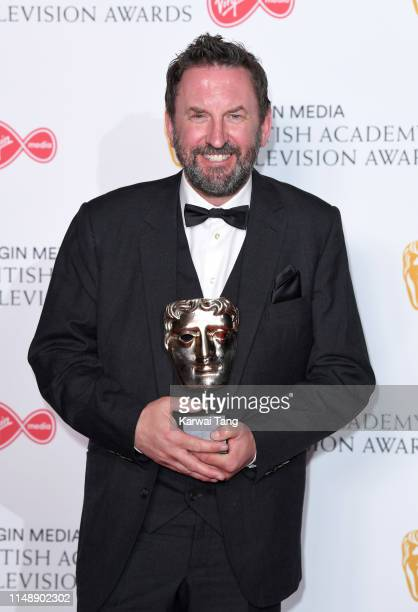Winner of the Entertainment Performance award for 'Would I Lie To You' Lee Mack poses in the Press Room at the Virgin TV BAFTA Television Award at...