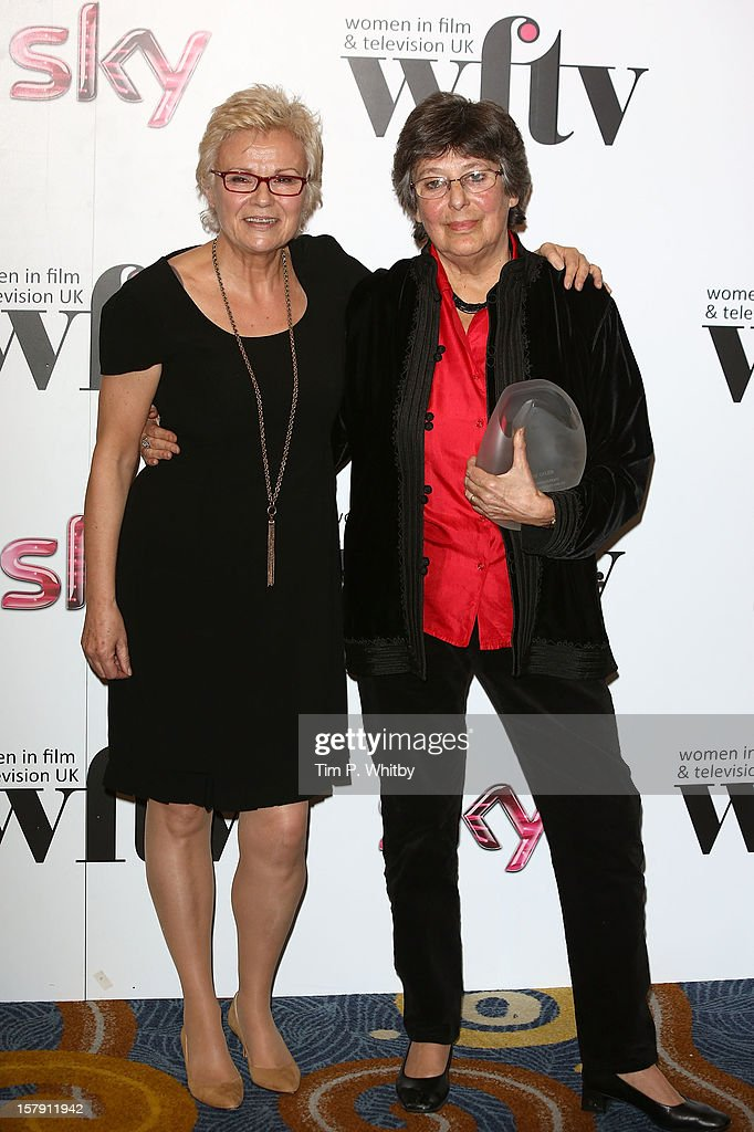 Winner of the EON Productions Lifetime Achievemen Award Ruth Caleb OBE (right) and Julie Walters pose for a photograph in the press room at the Women in TV & Film Awards at London Hilton on December 7, 2012 in London, England.