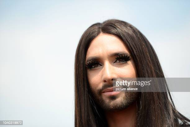 Winner of the Eurovision song contest Conchita Wurst participates in the Cologne Gay Pride parade in Cologne Germany 05 July 2015 137 groups...