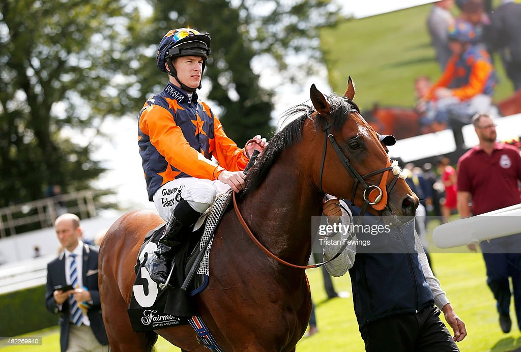 Winner of the Fairmont Molecomb Stakes, Richard Kingscote on horse Kachy on day two of the Qatar Goodwood Festival at Goodwood Racecourse on July 29, 2015 in Chichester, England.