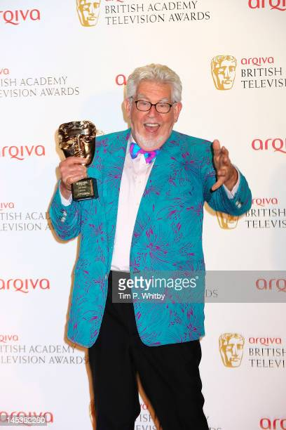 Winner of the Fellowship award Rolf Harris poses in front of the winners boards at The 2012 Arqiva British Academy Television Awards at the Royal...