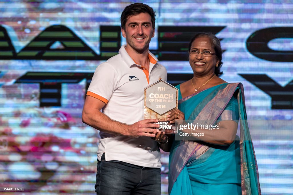 Winner of the FIH Female Coach of the Year Karen Brown of England award received by Adam Dixon [L] presented by Mariamma Koshy [R] President of...