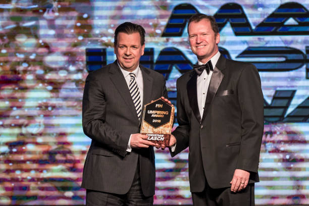 Winner of the FIH Male Umpiring Award Christian Blasch of Germany award received by Delf Ness [L] DHM Member presented by Jason McCraken [R] CEO of...