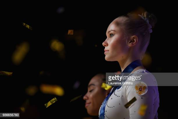 Winner of the gold medal Angelina Melnikova of Russia celebrates on the podium during day two of the 2018 Gymnastics World Cup at Arena Birmingham on...