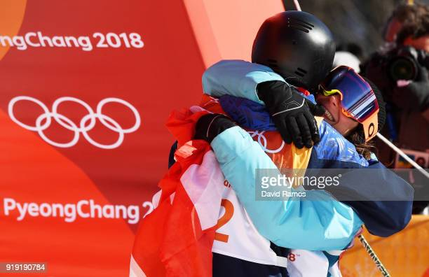 Winner of the gold Sarah Hoefflin of Switzerland celebrates with bronze medalist Isabel Atkin of Great Britain during the Freestyle Skiing Ladies'...