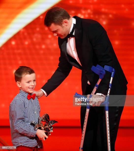 Winner of the Golden Heart Manuel Neuer and child Fredrik during the Ein Herz Fuer Kinder Gala show at Studio Berlin Adlershof on December 9, 2017 in...