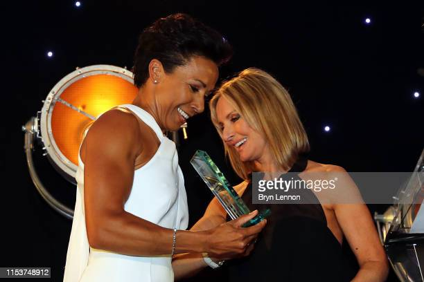 Winner of the Health & Fitness Book of the Year, Dame Kelly Holmes receives her award from Jacquie Beltrao during the Sports Book Awards at Lord's...
