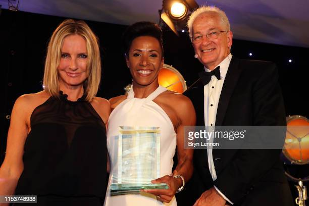 Winner of the Health & Fitness Book of the Year, Dame Kelly Holmes receives her award from Jacquie Beltrao and David Gower during the Sports Book...