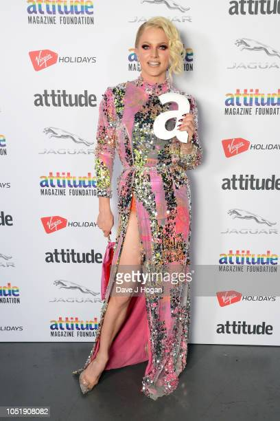 Winner of the 'Hero' award Courtney Act poses in the winner's room at The Virgin Holidays Attitude Awards at The Roundhouse on October 11 2018 in...