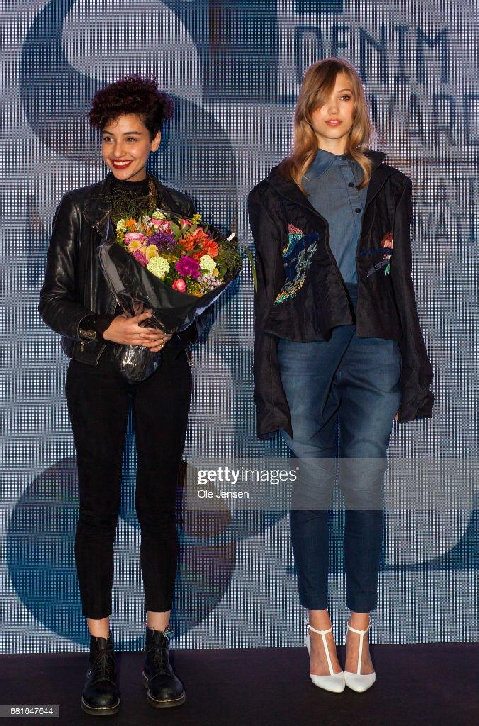 Winner of the Isko i-skool design award show Farah Sherif Wali (L) with a model wearing her winning design during Copenhagen Fashion Summit's press conference on May 10, 2017 in Copenhagen, Denmark.