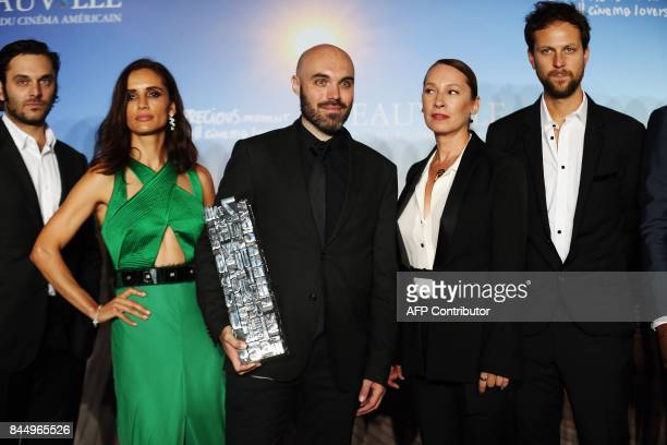 Winner of the Jury Prize the Revelation Prize and the Critic's Prize for his movie 'A Ghost Story' director David Lowery poses next to French actress...