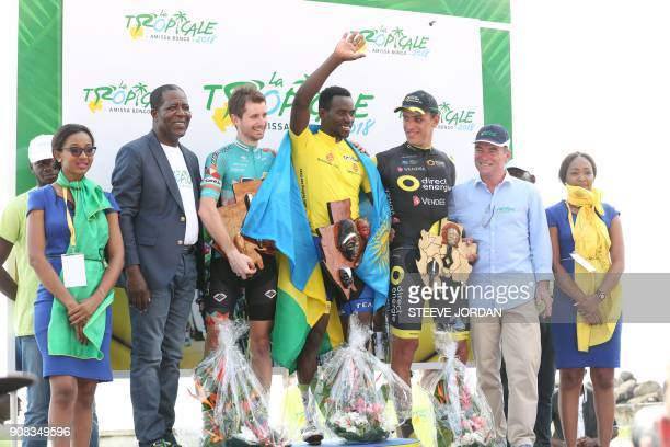 Winner of the La Tropicale cycling race 13th edition Rwanda's Joseph Areruya flanked by 2nd placed Germany's Nikodemus Holler of Bike Aid team 3rd...