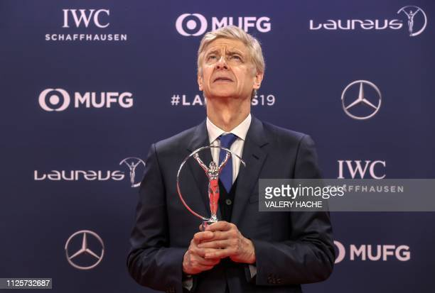 TOPSHOT Winner of the Laureus Lifetime Achievement award former Arsenal football team manager Arsene Wenger poses after receiving his award during...