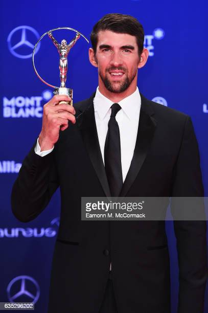 Winner of the Laureus World Comeback of the Year Swimmer Michael Phelps of the US poses with his trophy at the Winners Press Conference and Photocall...