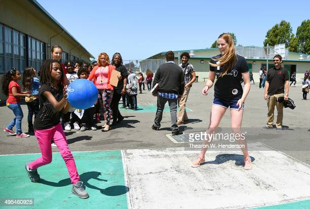 Winner of the Laureus World Sports Award for a female athlete and four-time Olympic gold medalist Missy Franklin plays fourquare with studends at...