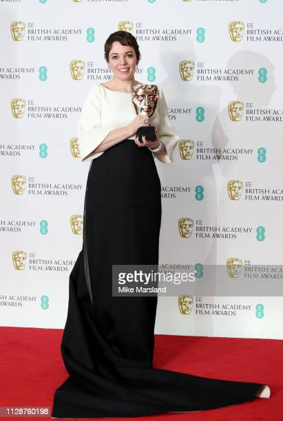 Winner of the Leading Actress award for The Favourite, Olivia Colman poses in the press room during the EE British Academy Film Awards at Royal...