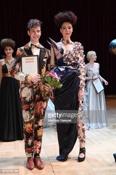 Winner of the LOB fashion award Jannik Kurz and a model pose during the Leipzig Opera Ball on November 4 2017 in Leipzig Germany