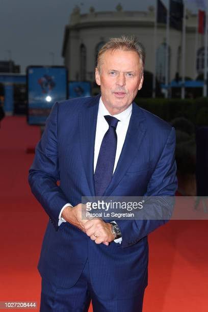 Winner of the Lucien Barriere Literary prize John Grisham arrives to attend his award ceremony on September 5 2018 in Deauville France