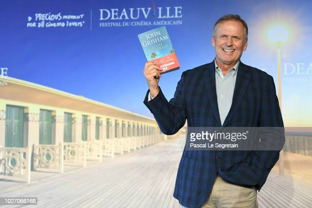 Winner of the Lucien Barriere Literary Prize John Grisham poses during a photocall on September 5 2018 in Deauville France