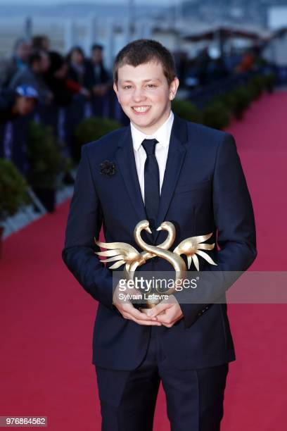 Winner of the Masculin Revelation Award Anthony Bajon attends the winners' red carpet of Cabourg Film Festival on June 16 2018 in Cabourg France