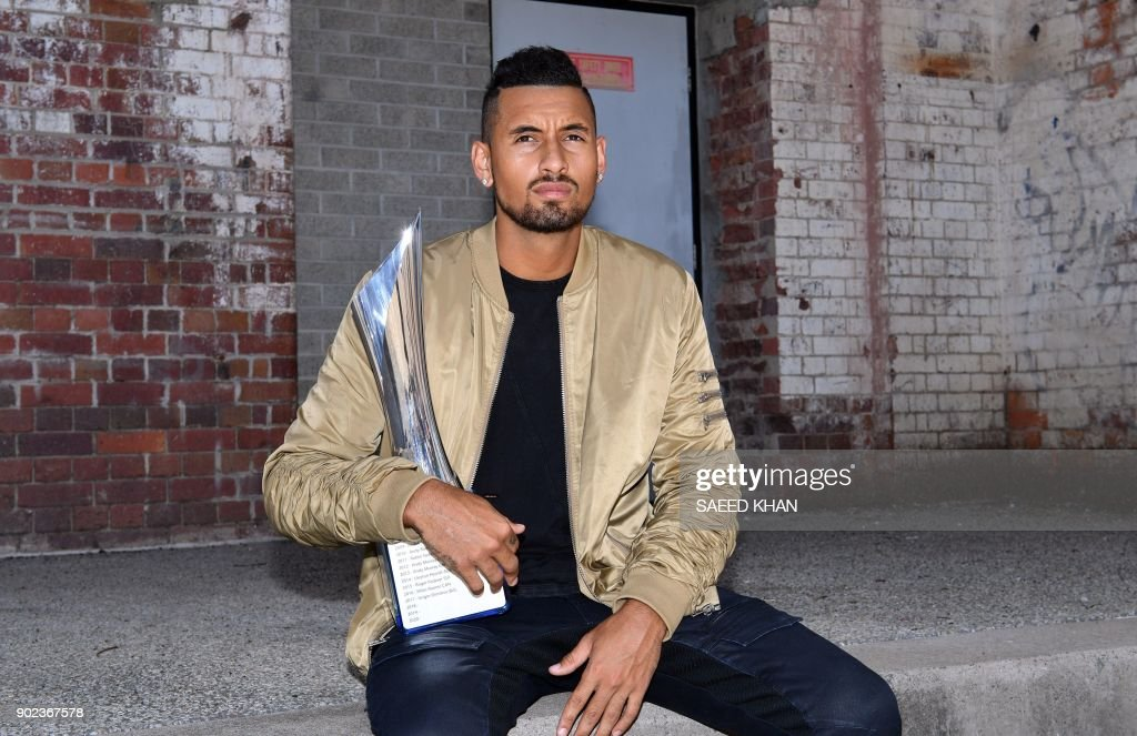 Winner of the men's singles Brisbane International tennis tournament on January 7, Nick Kyrgios of Australia, poses with the trophy a day after his victory in Brisbane on January 8, 2018. / AFP PHOTO / Saeed KHAN / --IMAGE