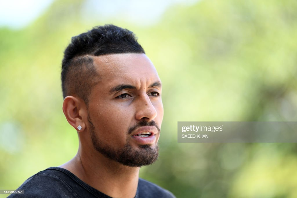 Winner of the men's singles Brisbane International tennis tournament on January 7, Nick Kyrgios of Australia, talks to the media a day after his victory in Brisbane on January 8, 2018. / AFP PHOTO / Saeed KHAN / --IMAGE