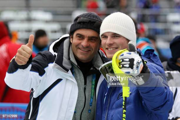 Winner of the Men's Slalom gold Giuliano Razzoli of Italy poses with Alberto Tomba after the Men's Slalom second run on day 16 of the Vancouver 2010...