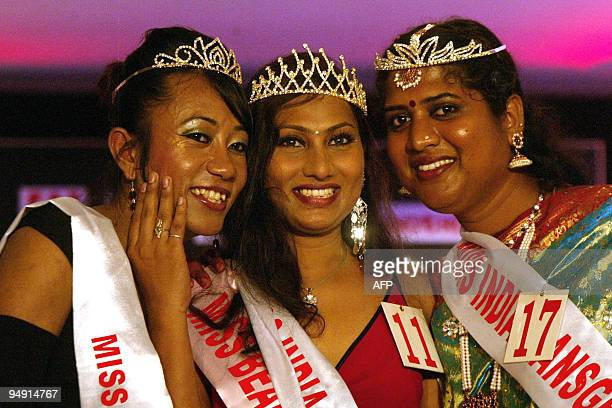 Winner of the Miss India Transgender pageant Karina Shalini from Mumbai celebrates with runner ups Romi from Manipur and Padmini of Tamil Nadu after...