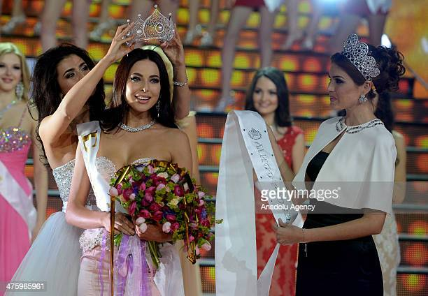 Winner of the Miss Russia 2014 beauty contest Yulia Alipova from Balakovo accepts her award during the Miss Russia 2014 beauty contest in Moscow...