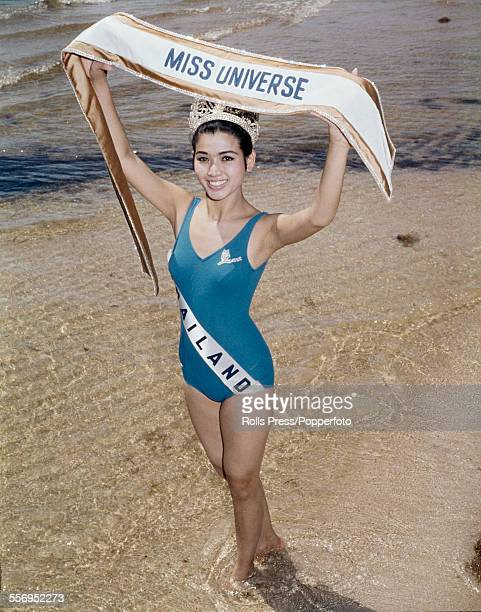 Winner of the Miss Universe 1965 pageant Apasra Hongsakula from Thailand pictured wearing a blue bathing costume and the winner's crown and sash on...