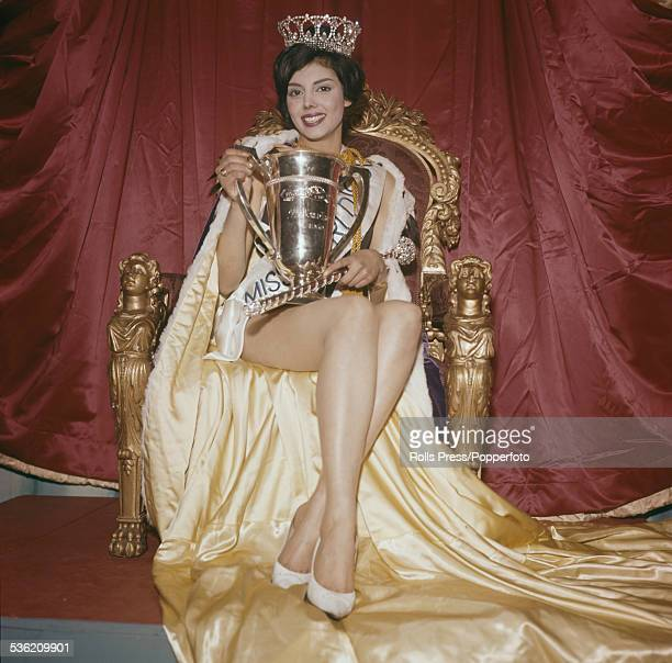 Winner of the Miss World competition Norma Gladys Cappagli of Argentina pictured sitting on a throne holding the winner's trophy at the Lyceum...