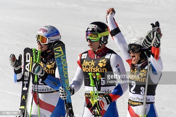 Winner of the Nation team event Switerzland team with Denise Feierabend Luca Aerni and Wendy Holdener celebrate at the arrival area of the Alpine...