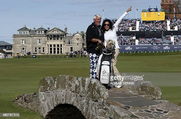 Winner of The Open in 1995 US golfer John Daly and his partner Anna Cladakis pose for a photograph on the Swilcan Bridge on the 18th hole with the...