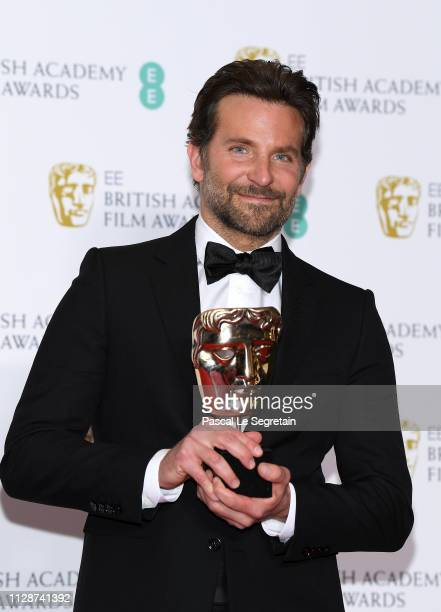 Winner of the Original Music award Bradley Cooper poses in the press room during the EE British Academy Film Awards at Royal Albert Hall on February...