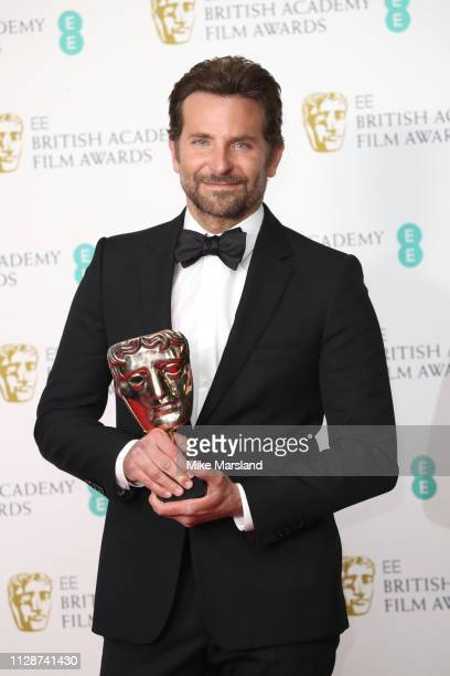 Winner of the Original Music award for A Star Is Born, Bradley Cooper poses in the press room during the EE British Academy Film Awards at Royal...